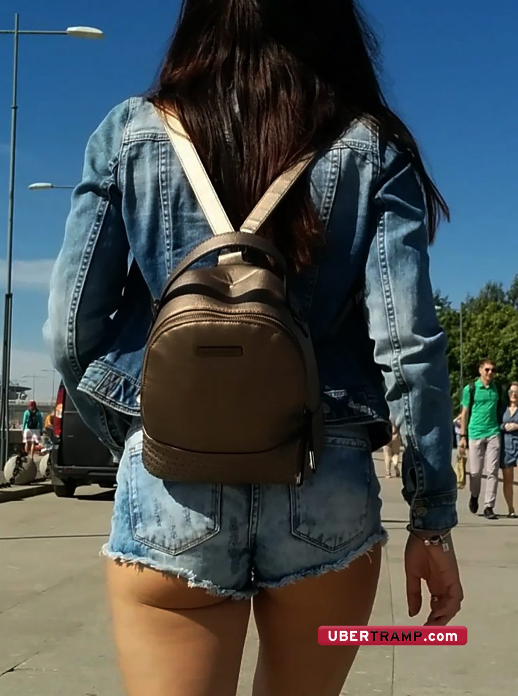 Sexy girl in shorts walking through the street