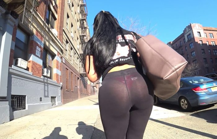 Sunlight makes red thong visible under tights