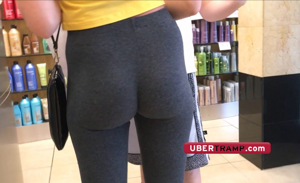 Small bubble buttocks clamp together in grey spandex tights