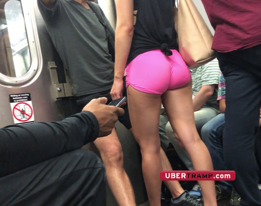 Leggy fitness girl caught by voyeur in the subway train