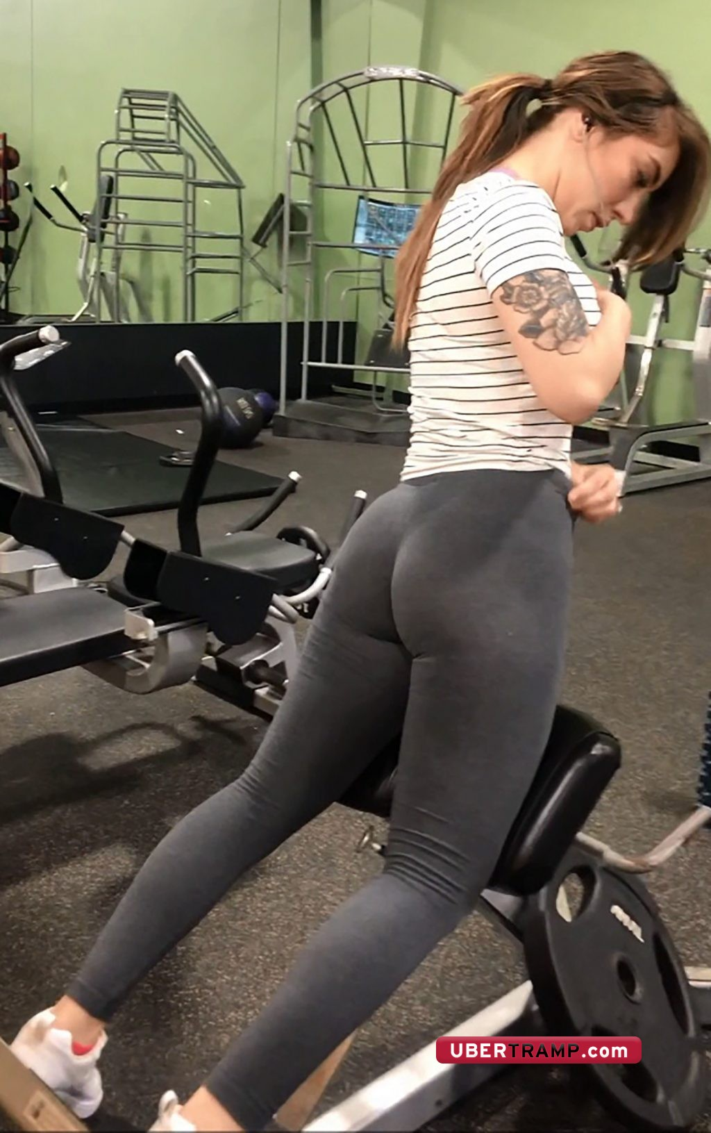 Gorgeous girl with tight clenched ass is recorded by gym voyeur