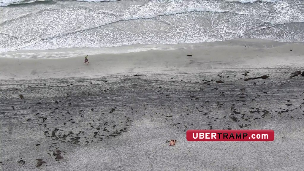 Voyeur shows how much he zooms in to see naked girls on beach