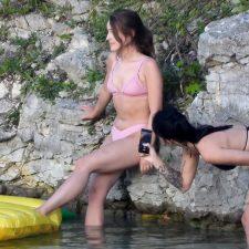 Teens snapping photos in bikinis